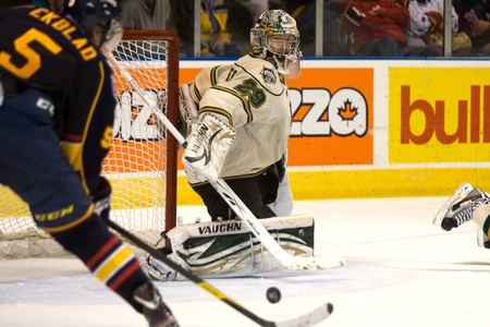 barrie: London Ontario, Canada - November 25, 2011. London Knight goalie Michael Houser (29) is caught out of position as 15 year old Aaron Ekblad (5) prepares to score in a Ontario Hockey League game between the Barrie Colts and the London Knights. The visiting