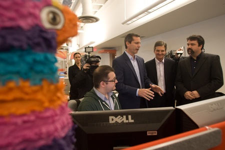 southwestern ontario: London Ontario, Canada - November 28, 2011. Dalton McGuinty Premier of Ontario speaks with Mukney Tipping, a designer with Digital Extremes (seated) Chris Bentley, MPP for London West, second from right and James Schmalz, president and founder or Digital  Editorial