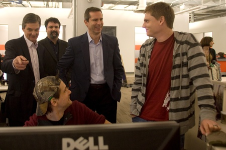 southwestern ontario: London Ontario, Canada - November 28, 2011. Dalton McGuinty, Premier of Ontario, centre talks with Casey Baldwin, right and Andrejs Verlis, seated, two designers with the computer game company Digital Extremes. McGuinty was on tour of the London company a
