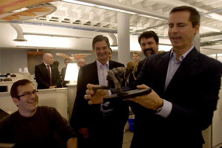 southwestern ontario: London Ontario, Canada - November 28, 2011. Dalton McGuinty, Premier of Ontario, right looks over a Darkling statue and shares a joke with Jeff Ross, left, Chris Bentley MPP - London West and James Schmalz, president and founder of Digital Extremes. McG Editorial