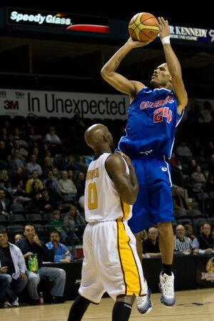 john labatt centre: London Ontario, Canada - November 17, 2011. Ralphy Holmes (24) of the Quebec Kebs goes up for basket against DeAnthony Bowden of the London Lightning during a National Basketball League of Canada game between the London Lightning and Quebec Kebs. London w Editorial