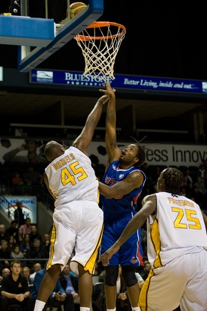 london lightning: London Ontario, Canada - November 17, 2011. Aaron Spears (50) of the Quebec Kebs watches the ball as he goes up for a basket against Shawn Daniels (45) of the London Lightning during a National Basketball League of Canada game between the London Lightning Editorial