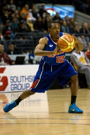 London Ontario, Canada - November 17, 2011. Royce Parran (12) of the Quebec Kebs makes a pass during a National Basketball League of Canada game between the London Lightning and Quebec Kebs. London won the game 85-79.