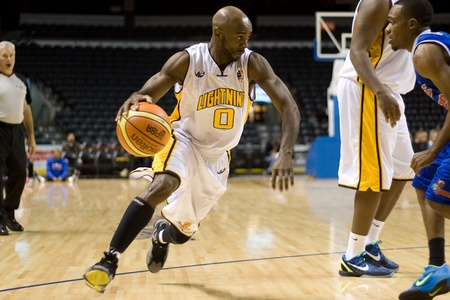 London Ontario, Canada - November 17, 2011. DeAnthony Bowden of the London Lightning carries the ball during a National Basketball League of Canada game between the London Lightning and Quebec Kebs. London won the game 85-79.