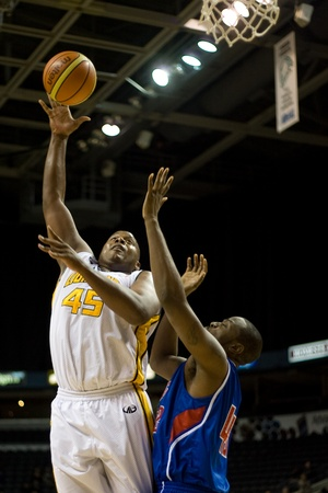 daniels: London Ontario, Canada - November 17, 2011. Shawn Daniels (45) goes up for basket against Ricky Volcy (42) during a National Basketball League of Canada game between the London Lightning and Quebec Kebs. London won the game 85-79.