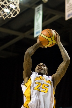 john labatt centre: London Ontario, Canada - November 17, 2011. Gabriel Freeman of the London Lighting goes up for a rebound during a National Basketball League of Canada game between the London Lightning and Quebec Kebs. London won the game 85-79.