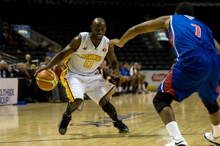 john labatt centre: London Ontario, Canada - November 17, 2011. DeAnthony Bowden of the London Lightning looks for a way around Quebec Keb play Shaun Fountain (7) during a National Basketball League of Canada game between the London Lightning and Quebec Kebs. London won the  Editorial