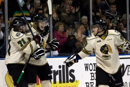 chris: London Ontario, Canada - November 18, 2011. Chase Hatcher, centre celebrates with Chris Tierney (71) and Brett Welychka (27) after scoring his first OHL goal during a Ontario Hockey League game between the Plymouth Whalers and the London Knights at the Jo