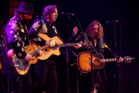 fearing: Hamilton Ontario, Canada - November 19, 2011. From left to right Colin Linden, Stephen Fearing and Tom Wilson of Blackie and the Rodeo Kings performs at the 2011 Hamilton Music Awards Gala held at Mohawk College.