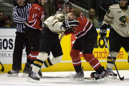 john labatt centre: London Ontario, Canada - November 20, 2011: Kevin Raine (20) and Daniel Zweep (25) fight during an Ontario Hockey League game between the London Knights and Owen Sound Attack. London won the game in overtime 3-2.