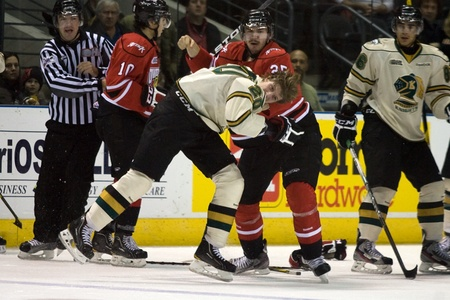 john labatt centre: London Ontario, Canada - November 20, 2011: Kevin Raine (20) of the London Knights fights with Daniel Zweep (25) of the Owen Sound Attack during an Ontario Hockey League game between the London Knights and Owen Sound Attack. London won the game in overtim