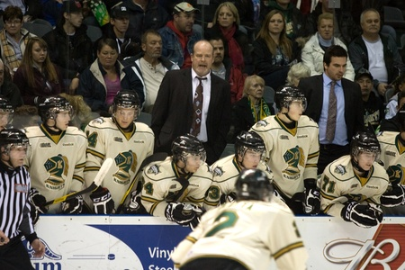 john labatt centre: London Ontario, Canada - December 2, 2011. Mark Hunter, centre, makes his debut as Head Coach for the London Knights in a Ontario Hockey League game between the Saginaw Spirit and the London Knights. London won the game 6-0.