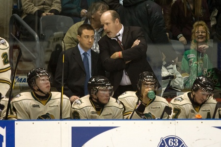 john labatt centre: London Ontario, Canada - December 2, 2011. Mark Hunter, right makes his debut as Head Coach of the London Knights talks with assistant coach assistant general manager Misha Donskov in a Ontario Hockey League game between the Saginaw Spirit and the London
