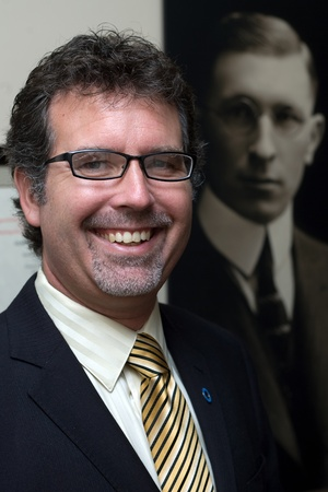 national historic site: London Ontario, Canada - August 5, 2011. Grant Maltman, Curator at Banting House. He is photographed in front of a portrait of Dr. Frederick Bantings located inside Banting House in London Ontario Canada. It was inside this house that Dr. Frederick Banti Editorial