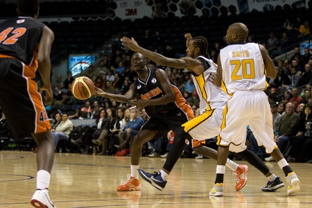 London Ontario, Canada - December 10, 2011. Tut Ruach (4) makes a pass in a National Basketball League of Canada game between the Oshawa Power and the London Lightning. The visiting Oshawa Power handed London their third loss of the season winning 99-93 l