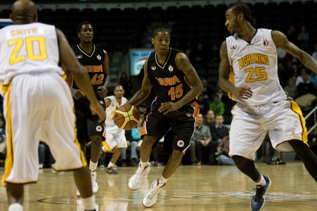 London Ontario, Canada - December 10, 2011. Brandon Robinson (15) carries the ball in a National Basketball League of Canada game between the Oshawa Power and the London Lightning. The visiting Oshawa Power handed London their third loss of the season win Editorial