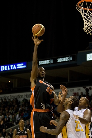 powe: London Ontario, Canada - December 10, 2011. David Collins (55) goes up for a basket against Gabe Freeman (25) and Shawn Daniels (45) in a National Basketball League of Canada game between the Oshawa Power and the London Lightning. The visiting Oshawa Powe Editorial