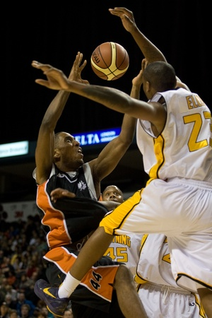 london lightning: London Ontario, Canada - December 10, 2011. Paul Campbell (44) goes up for a basket against Tim Ellis (23) in a National Basketball League of Canada game between the Oshawa Power and the London Lightning. The visiting Oshawa Power handed London their thir Editorial