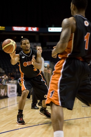 london lightning: London Ontario, Canada - December 10, 2011. Larry Diamond (2) makes a pass to Marcus Johnson (1) in a National Basketball League of Canada game between the Oshawa Power and the London Lightning. The visiting Oshawa Power handed London their third loss of