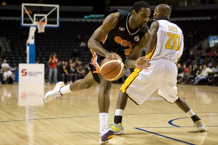 john labatt centre: London Ontario, Canada - December 10, 2011. Akeem Wright (35) drives around Eddie Smith (20) in a National Basketball League of Canada game between the Oshawa Power and the London Lightning. The visiting Oshawa Power handed London their third loss of the