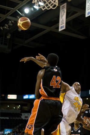 daniels: London Ontario, Canada - December 10, 2011. Shawn Daniels (45) has his shot blocked by Omari Johnson (42) in a National Basketball League of Canada game between the Oshawa Power and the London Lightning. The visiting Oshawa Power handed London their third Editorial