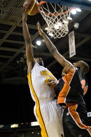 London Ontario, Canada - December 10, 2011. Tim Ellis (23) goes up for a basket against Paul Campbell (44) in a National Basketball League of Canada game between the Oshawa Power and the London Lightning. The visiting Oshawa Power handed London their thir Editorial