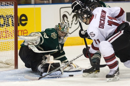 john labatt centre: London Ontario, Canada - December 16, 2011. London Knight goalie Michael Houser makes a save on Jason Dickinson (11) in an Ontario Hockey League game between the London Knights and Guelph Storm played at the John Labatt Centre in London. The Knights won t Editorial
