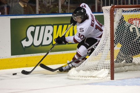 john labatt centre: London Ontario, Canada - December 16, 2011. Guelph Storm forward Francis Menard (10) carries the puck behing the London net in an Ontario Hockey League game between the London Knights and Guelph Storm played at the John Labatt Centre in London. The Knight