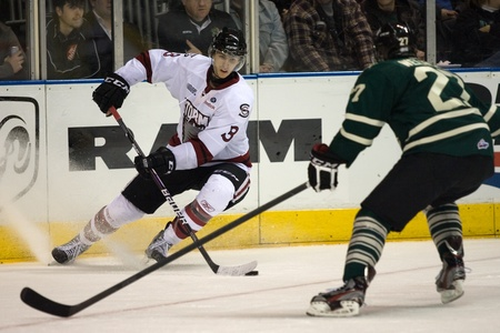 john labatt centre: London Ontario, Canada - December 16, 2011. Guelph Storm player Andrey Pedan looks for a pass while Brett Welychka (27) forechecks in an Ontario Hockey League game between the London Knights and Guelph Storm played at the John Labatt Centre in London. The