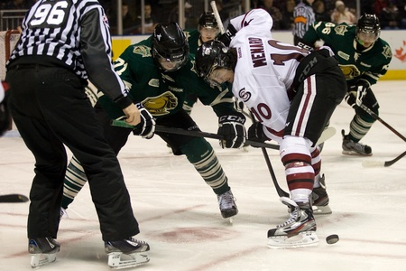 London Ontario, Canada - December 16, 2011. Francis Menard (10) of the Guelph Storm wins a faceoff against Chris Tierney in an Ontario Hockey League game between the London Knights and Guelph Storm played at the John Labatt Centre in London. The Knights w