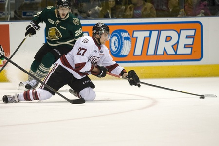 john labatt centre: London Ontario, Canada - December 16, 2011. Guelph Storm player Tanner Richard (27) tries to make a pass from his knees in an Ontario Hockey League game between the London Knights and Guelph Storm played at the John Labatt Centre in London. The Knights wo
