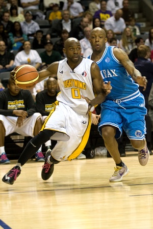 London Ontario, Canada - March 25, 2012. DeAnthony Bowden of the London Lightning drives to the basket in game five. The London Lightning defeated the Halifax Rainmen 116-92 in the fifth and deciding game to win the National Basketball League of Canadas