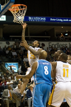 London Ontario, Canada - March 25, 2012. London Lightning player and league MVP Gabe Freeman goes up for a basket in game five. The London Lightning defeated the Halifax Rainmen 116-92 in the fifth and deciding game to win the National Basketball League o Editorial