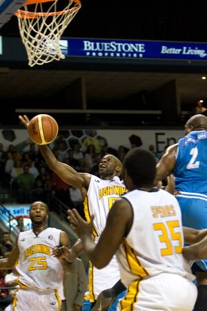 halifax rainmen: London Ontario, Canada - March 25, 2012. DeAnthony Bowden (0) is fouled as he goes up for a basket. The London Lightning defeated the Halifax Rainmen 116-92 in the fifth and deciding game to win the National Basketball League of Canadas championship. Lon Editorial