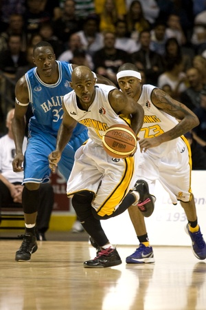 London Ontario, Canada - March 25, 2012. DeAnthony Bowden (0) looks for a pass as he drives up the court in game five.  The London Lightning defeated the Halifax Rainmen 116-92 in the fifth and deciding game to win the National Basketball League of Canada