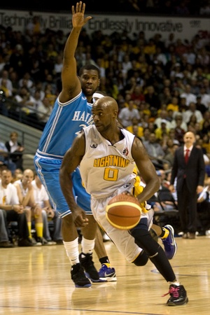 London Ontario, Canada - March 25, 2012. DeAnthony Bowden (0) drives to the basket in game five. The London Lightning defeated the Halifax Rainmen 116-92 in the fifth and deciding game to win the National Basketball League of Canadas championship. London