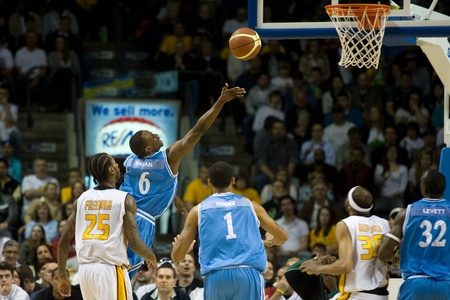 john labatt centre: London Ontario, Canada - March 25, 2012. Chris Hagan (6) goes up for a basket in game five. The London Lightning defeated the Halifax Rainmen 116-92 in the fifth and deciding game to win the National Basketball League of Canadas championship. London play Editorial