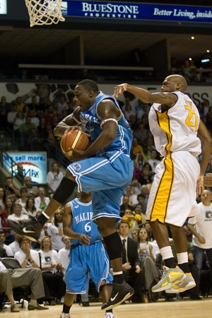 halifax rainmen: London Ontario, Canada - March 25, 2012. Tyrone Levett (32) of the Halifax Rainmen collects a rebound from Eddie Smith in game five.  The London Lightning defeated the Halifax Rainmen 116-92 in the fifth and deciding game to win the National Basketball Le Editorial