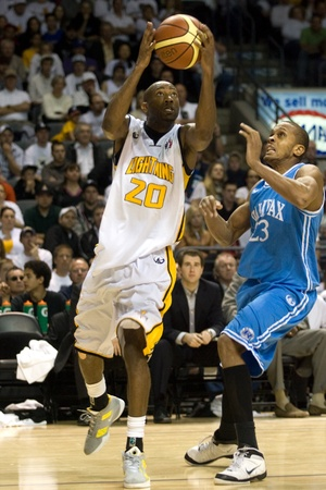 London Ontario, Canada - March 25, 2012. Eddie Smith (20) of the London Lightning prepares for a shot in game five. The London Lightning defeated the Halifax Rainmen 116-92 in the fifth and deciding game to win the National Basketball League of Canadas c Editorial
