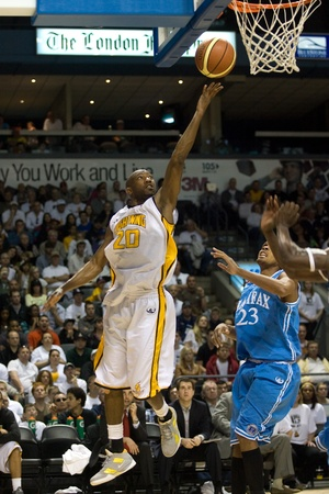 London Ontario, Canada - March 25, 2012. Eddie Smith of the London Lightning goes up for a basket in game five.  The London Lightning defeated the Halifax Rainmen 116-92 in the fifth and deciding game to win the National Basketball League of Canadas cham