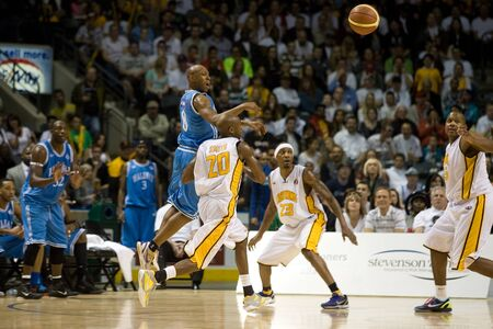 halifax rainmen: London Ontario, Canada - March 25, 2012. Taliek Brown (8) of the Halifax Rainmen makes a pass during game five. The London Lightning defeated the Halifax Rainmen 116-92 in the fifth and deciding game to win the National Basketball League of Canadas champ