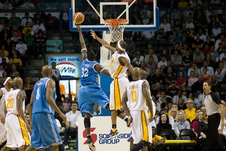 London Ontario, Canada - March 25, 2012.  Tyrone Levett (32) of the Halifax Rainmen goes up for a basket. The London Lightning defeated the Halifax Rainmen 116-92 in the fifth and deciding game to win the National Basketball League of Canadas championshi