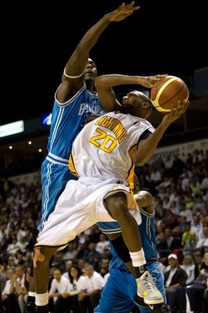 London Ontario, Canada - March 25, 2012. Eddie Smith (20) of the London Lightning is fouled by Tyrone Levett of the Halifax Rainmen.  The London Lightning defeated the Halifax Rainmen 116-92 in the fifth and deciding game to win the National Basketball Le