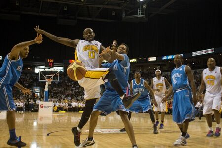 london lightning: London Ontario, Canada - March 25, 2012. London Lightning DeAnthony Bowden (0) is fouled as he drives to the basket.  The London Lightning defeated the Halifax Rainmen 116-92 in the fifth and deciding game to win the National Basketball League of Canadas Editorial