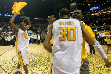 London Ontario, Canada - March 25, 2012. Shawn Daniels (45), Rodney Buford and Micheal Ray Richardson celebrate after winning the league championship. The London Lightning defeated the Halifax Rainmen 116-92 in the fifth and deciding game to win the Natio