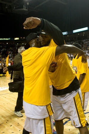 London Ontario, Canada - March 25, 2012. DeAnthony Bowden, left and Gabe Freeman celebrate after winning the league championship. The London Lightning defeated the Halifax Rainmen 116-92 in the fifth and deciding game to win the National Basketball League