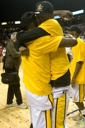 london lightning: London Ontario, Canada - March 25, 2012. DeAnthony Bowden, left and Gabe Freeman celebrate after winning the league championship. The London Lightning defeated the Halifax Rainmen 116-92 in the fifth and deciding game to win the National Basketball League