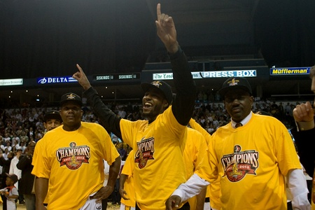 London Ontario, Canada - March 25, 2012. Gabe Freeman is flanked by Shawn Daniels, left and Coach Michael Ray Richardson. The London Lightning defeated the Halifax Rainmen 116-92 in the fifth and deciding game to win the National Basketball League of Cana