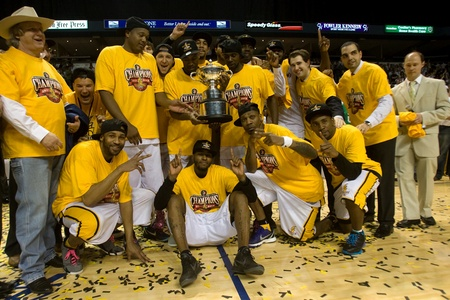 London Ontario, Canada - March 25, 2012. Members of the London Lightning pose with the League Championship Trophy.  The London Lightning defeated the Halifax Rainmen 116-92 in the fifth and deciding game to win the National Basketball League of Canadas c Editorial