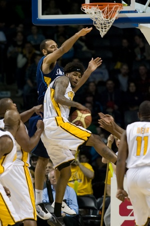 john labatt centre: London Ontario, Canada - March 9, 2012. Gabe Freeman of the London Lightning collects a rebound in game two of their best of three first round, the Ligthning won the first round of the playoffs defeating the Saint John Mill Rats 87-82 in front of a record